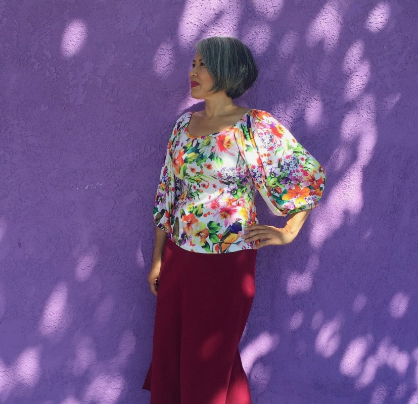 ID: Asian woman wearing Adrienne Blouse in rayon floral knit fabric, Friday Pattern Company design