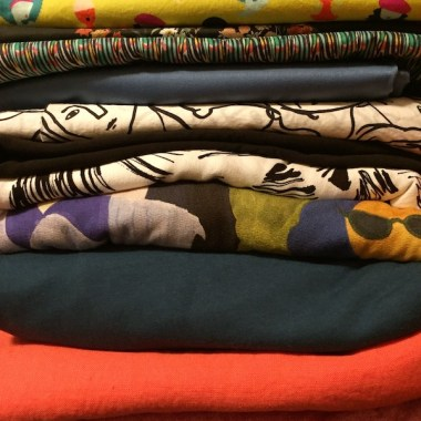 Stack of several fabrics - prints and solids