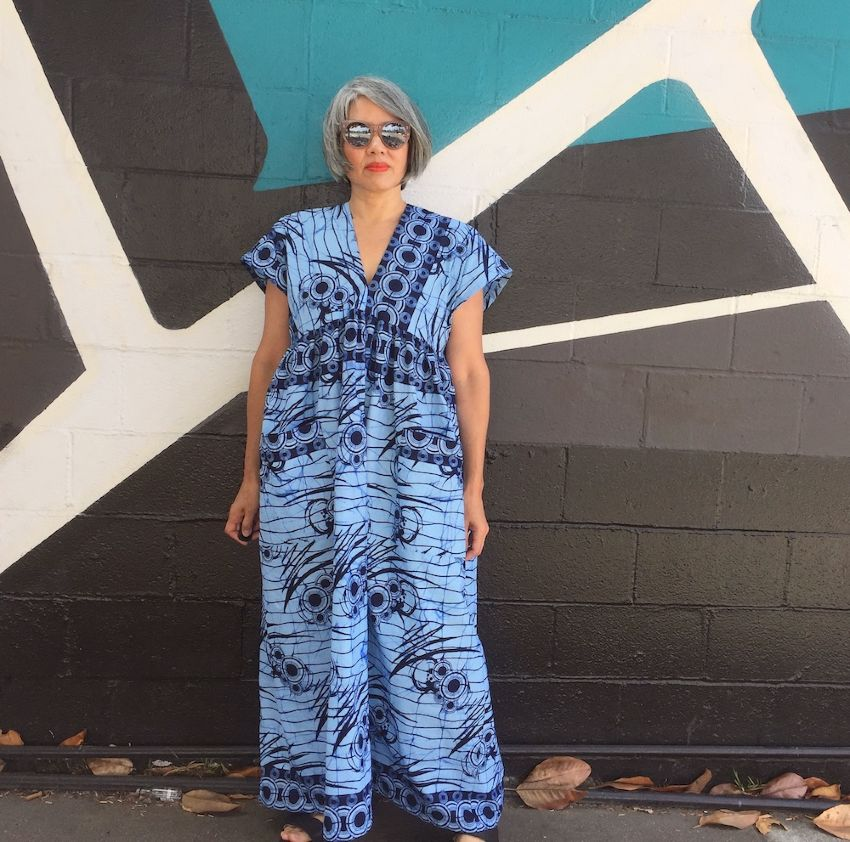 Asian woman wearing Cris Wood Parasol Dress in Ankara fabric