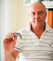 Man holding mouthguard.