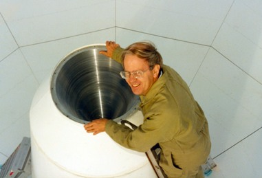 Bruce Thomas inspecting the (large) corrugated-horn on an 18-m antenna prior to testing