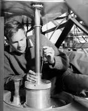 Bruce Thomas attaching a dual-hybrid-mode corrugated-horn in the focus cabin at the Parkes radio telescope in 1968