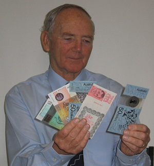 Dave Solomon holding a handful of various banknotes
