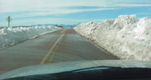 (U.S. Air Force photo/Capt. David Weide) A driver makes his way to work after a blizzard in 2006. The 50th Security Forces Squadron teams up with wing leadership to determine road conditions on and around Schriever.