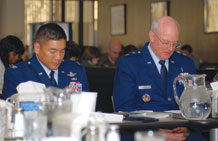 (U.S. Air Force photo/Staff Sgt. Stacy Foster) Col. Cary Chun and Chaplain (Maj. Gen.) Cecil Richardson bow their heads in prayer during the invocation at the National Prayer Breakfast held in the Satellite Dish Dining Facility Feb. 24. Colonel Chun is the 50th Space Wing commander. Chaplain Richardson is the Air Force chief of chaplains and was the guest speaker at the event.