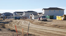 (Courtesy photo) Construction continues on Johnston Street in the new base housing area here March 5. Since October 2008, 51 of the houses have been framed, forming the new neighborhood.