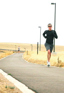 (U.S. Air Force photo/Scott Prater) Aaron Pinson climbs the final hill enroute to a victory in the St. Patty's Day 5K run here March 20. Pinson was among 120 runners who raced the new course near Schriever's housing area.