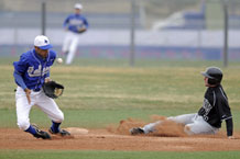 Air Force shortstop stops the ball as an UNLV baserunner steals second base. Photo by Mike Kaplan