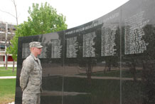 Cadet 4th Class Derek Winkler peers at the names of Academy graduates who lost their lives in war. The War Memorial is an element of the Air Garden on the Terrazzo.