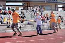 Soldiers from 1st Platoon, 60th Ordnance Company, 43rd Sustainment Brigade, help a Special Olympian during the Special Olympics Southeast Area Athletic Meet at St. Mary High School's Grace Center athletic complex May 7.