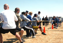 (U.S. Air Force photo/Staff Sgt. Daniel Martinez) The 3rd Space Experimentation Squadron team and the 50th Operations Group team duke it out during the tug-of-war event at the Third Annual 4-Fit Challenge.