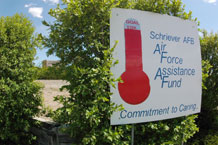 (U.S. Air Force photo/Scott Prater) An on-base indicator informs Schriever personnel of the total contributions received during the five-week fundraising campaign for the Air Force Assistance Fund. Schriever met 76 percent of its $32,972 goal when the program ended May 1.
