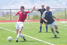 (Courtesy photo) Ben Kissell delivers a pass during Schriever FC's Division III championship victory over Rocky Mountain United May 17 at St. Mary's stadium.