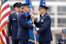 Photo by Dennis Rogers Lt. Gen. Michael Gould (right) accepts the U.S. Air Force Academy guidon from Gen. Norton Schwartz, chief of staff of the Air Force, during a change of command ceremony at the Academy June 9.