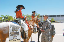 Cadet 3rd Class Jared Barkemeyer talks to April Biernat, the Girl of the West, during her visit to the Academy Monday. The Girl of the West and her Aide, Jessica Greene, toured the Academy promoting the 2009 Pikes Peak or Bust Rodeo. Photo by Denise Navoy