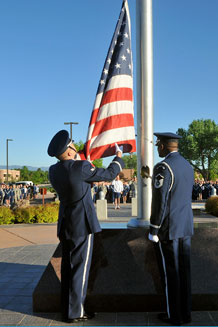 (Air Force photo by Dennis Howk) Master Sgt. Andrew Fulbright and Airman 1st Class Shawn Dunag of the Peterson Honor Guard prepare to raise the Colors in honor of Paul Airey, the first Chief Master Sergeant of the Air Force, during a formation held at the 21st Space Wing headquarters building flagpole May 28. After raising the colors, the flag was lowered to half-staff to honor the chief. Approximately 200 Peterson Airmen stood in a formation led by Col. Jay Raymond, 21st SW commander and Chief Master Sgt. Tim Omdal, 21st SW command chief. Chief Airey was also honored at Arlington National Cemetery, Washington, D.C., where he is scheduled to be interred May 28. Chief Airey died on March 20, 2009.
