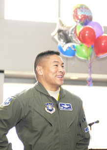 U.S. Air Force photo/Amber Whittington Col. Cary Chun, 50th Space Wing commander, reacts to a surprise party held to celebrate his selection for promotion to brigadier general May 15 in the DeKok Building atrium. Colonel Chun will pin his star on in a ceremony officiated by Gen. Robert C. Kehler, Air Force Space Command commander, July 16.