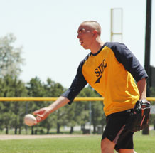 Alex Sanchez, pitcher for Space Innovation and Development Center, delivers a pitch to home plate during intramural softball action here July 14. National Reconnaissance Office Operations Squadron defeated SIDC 22-4.