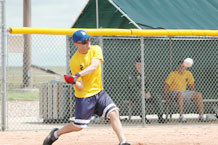 Brian Eno, 2nd Space Operations Squadron third baseman, smashes an RBI single through the middle of the infield during the fourth inning of 2nd SOPS' 17-10 victory over 50th Space Communications Squadron July 21.