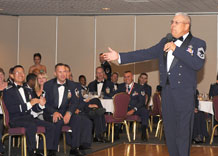 Retired Chief Master Sgt. Bob Vasquez, course director at the U.S. Air Force Academy's Center for Character Development, addresses Schriever and Peterson's newest senior non-commissioned officers during an induction ceremony at the Peterson Consolidated Club July 24. The ceremony honored 26 Airmen who were inducted into the senior NCO ranks.