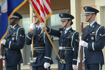Members of the High Frontier Honor Guard post the colors during a ribbon-cutting ceremony  Aug. 26 to officially open the first-ever base housing here.