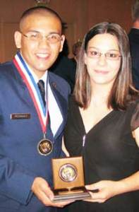 Aurora, Colo. -- Airman 1st Class Mark Rodriguez and his wife Casandra pause for a photo following the Colorado State Air Force Association award ceremony July 24. Airman Rodriguez earned the 2009 Colorado State Airman of the Year honor. (Courtesy photo)