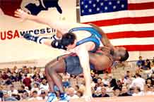 Photo by Tim Hipps.  Dremiel Byers, right, throws U.S. Army World Class Athlete Program teammate Paul Devlin during the 2009 U.S. National Wrestling Championships in Las Vegas recently.