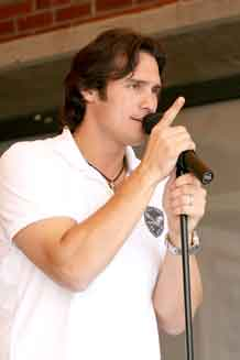 """Country singer Joe Nichols performs """"Size Matters"""" at the Fort Carson USO Aug. 25."""