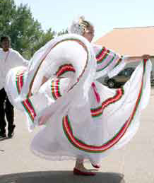 Christina Cisneros, 15, and Dyvon Walker, 16, conclude the Danzas Folkloricas Panamericans performance with the La Espina dance Saturday at the Fall Fiesta.