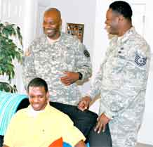 Sgt. 1st Class Travion Smith, center, Warrior Transition Battalion, and his friend, Tech. Sgt. Rodney Reed, right, Peterson Air Force Base's 21st Space Wing, visit with Jeremy Russeau. Smith and Reed assisted Russeau after he was struck by a car.