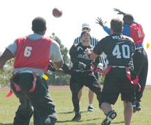Kyle Buck, quarterback for Missile Defense Integration and Operations Center attempts a pass during the second quarter of MDIOC's semifinal loss to 11th Space Warning Squadron.