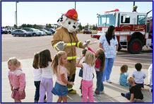 """Sparky"" visits children at the Child Development Center Summer 2009. Fire Prevention Week is Oct. 4-10."