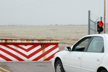 U.S. Air Force photo/Scott Prater Pop-up barriers inside the entry gates at Schriever are designed to control on-base traffic. A stop signal near the barrier indicates to drivers that the barrier has been deployed.