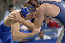 Junior Joseph Stafford wrestles Colorado School of Mines' Jacob Guynes, a sophomore, in the 165-lb. weight class during Air Force's first home contest of the season at the Air Force Academy's Clune Arena Dec 11. Photo by J. Rachel Spencer.