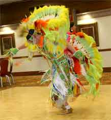 Members of the Seven Falls Dance Troupe performs during the Native American History Month celebration.