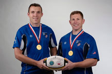 Marc Ward (left), Space Force Enhancement test analyst for Air Force Operational Test and Evaluation Center, and Thomas Beers, 721st Mission Support Group operations officer, are members of the 2009 Air Force rugby team. Air Force decisively won its sixth consecutive gold medal at the annual Armed Forces Rugby Championship tournament Nov. 13 at Fort Benning, Ga. In five games, Air Force outscored the opposition 226-3. Air Force then went on to defeat the Royal Australian Air Force rugby team, which had challenged Air Force to the match. (Air Force