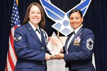 Senior Airman Kristina Robinson, 50th Comptroller Squadron, accepts the Levitow award as the top graduate of the Peterson AFB Airman Leadership School from Oct. 15 to Nov. 19, 2009. Chief Master Sergeant Idalia A. Peele, superintendent, 721st Communication Squadron, presented the award.