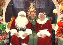 The Wing King visits with Season Royalty during the Children's Holiday party.