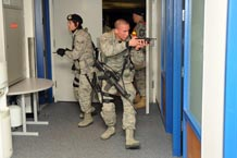 Airmen with the 10th Security Forces Squadron clear a room while responding to an active shooter scenario during the Academy's exercise Jan. 20. Photo by Johnny Wilson