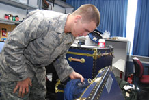 Cadet 4th Class Lee Bussey pulls personal belongings out of a trunk in his new dormitory in the Academy's Vandenberg Hall Monday. Photo by Staff Sgt. Don Branum