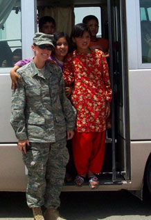 Senior Airman Sabrina Lyon is photographed with Afghan girls while deployed to Afghanistan. Airman Lyon is assigned to the 10th Aerospace Medicine Squadron. (U.S. Air Force photo)