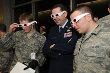 Cadet 4th Class Kyle Schory, Lt. Col. David Bibighaus and Cadet 3rd Class Robert Cilla watch a 3-D presentation at the Department of Computer Science station during Majors' Night Feb. 11. Photo by Rachel Boettcher