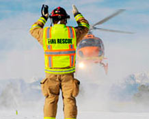 A Colorado Flight for Life helicopter is guided in by a Schriever fireman during an exercise Feb. 10. The helicopter and crew added to the realism of the exercise scenario and simulated transport of a mock victim. (U.S. Air Force Photo/Dennis Rogers)