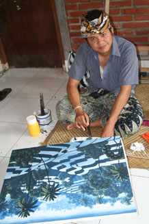A painter works on an exotic modern landscape at the Semar Kuning cooperative gallery in the painting village of Lodtunduh on Bali. Photo courtesy of Patricia Woeber.