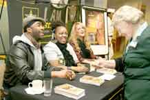 "Aggie Henderson, right, Wolf Dining Facility cashier, is all smiles after collecting the autographs of, from left, Antar ""CZAR Absolute"" Jackson, Lakeisha Taylor and Leigh Jones Feb. 24 during a meet-and-greet session at Wolf prior to the free I. AM. Strong concert."