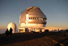 Chilly visitors enjoy sunset at the observatory atop Hawaii's Mauna Kea Mountain. Photo courtesy of Patricia Arrigoni.