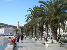 Visitors to Split, Croatia, walk along the waterfront promenade in front of the fourth-century palace built for Diocletian, the Roman emperor. Photo courtesy of Sandra Scott.