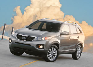 The 2011 Kia Sorento EX V-6 comes with the third-row seat, rear air conditioning and access to more option packages, such as a panoramic sunroof.