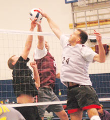 Team Schriever's Bill Witwicky and Craig Armogida battle a Team Peterson player for control at the net during round-robin play in the Rocky Mountain Volleyball Championships at the fitness center here.  (U.S. Air Force photo/Scott Prater)