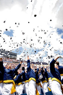 Hats fly as the Air Force Thunderbirds fly over 1,001 newly minted 2nd Lieutenants during the U.S. Air Force Academy Class of 2010 Graduation Ceremony at Falcon Stadium, May 26. Photo by Bill Evans
